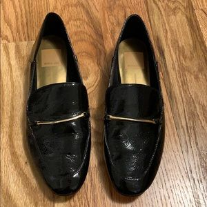 Glossy black loafer with gold accent